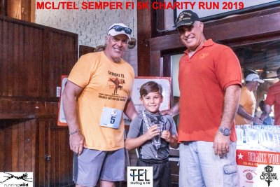 2019-TEL-MCL-Semper-Fi-5k-Charity-Run-for-the-Children-Fun-Run-Pensacola-FL_handing-out-the-awards_TEL-Business-Consultant-Jim-Grant