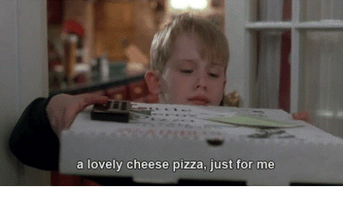 Kevin from Home alone with a cheese pizza