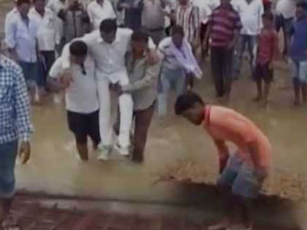 Odisha MLA Manas Madkami does a Shivraj, crosses mud in supporters' arms