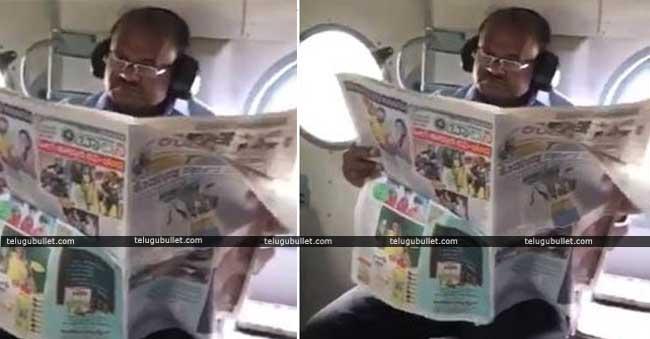 kumaraswamy-reading-news-paper-in-aerial-survey-video-goes-viral