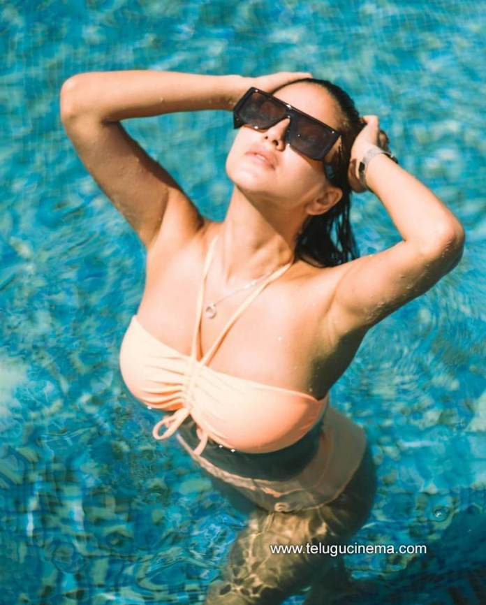 Sunny Leone in a swimming pool