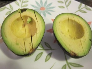 This is how you slice and serve a perfect Avocado. Just run your knife gently down the length and then scoop out with a tablespoon