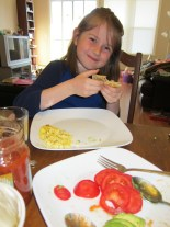 """Thing 2 is not a big fan of eggs, but she likes """"scrambled"""". Her brinner burrito was filled with avocado and tomatoes!"""