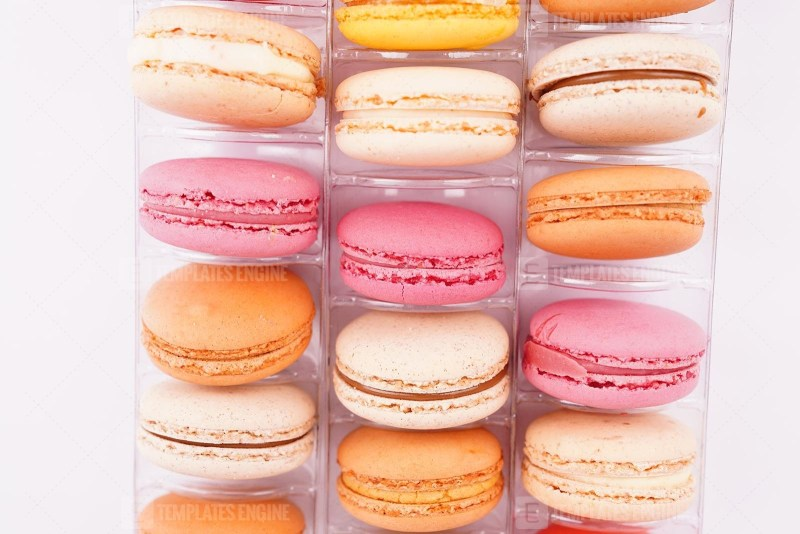 Assorted colorful macaroons in transparent box
