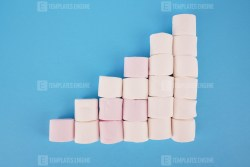 Growing bar chart with marshmallows on blue background