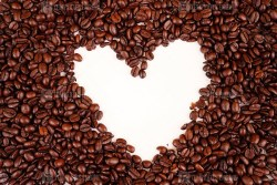 Top view of coffee beans in heart-shaped on white