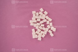 Cube sugar on rose background stock photo