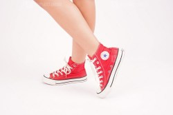 Girl Wears Red All Star Sneakers