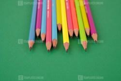 Pencils on Green Stock Photo