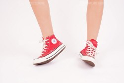 Red converse on woman legs