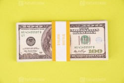 Stack of Dollar banknotes on green background