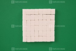 Stack of cube sugar on green background