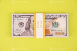 Ten Thousand dollars on bright green background