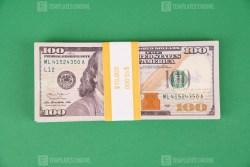 Ten Thousand dollars on green background