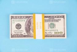Thousand dollars on blue background