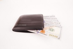 Wallet with hundred dollar banknotes