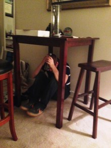 So sad to see all our friends leave, Andrew hid under the table at Danielle's house.