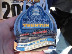Sissy's medal for completing the 2014 Trenton Half Marathon.
