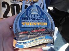 Sissy's medal for completing the 2014 Trenton Half Marathon.