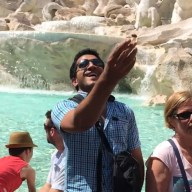 Flipping a coin into the Trevi Fountain