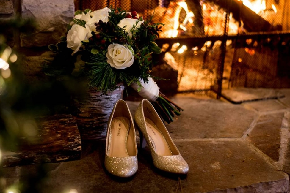 Wedding shoes and bouquet by a cosy fire