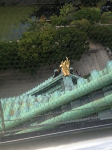 The view of a statue from the roof. They had screens to keep people from falling.
