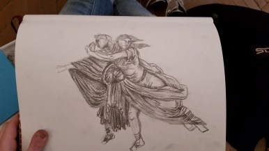 My rendering of the two figures- turns out, I have no idea how to draw arms or legs. Or hair.