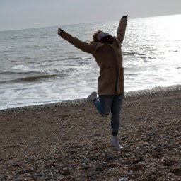 The world's most ridiculous cheerleader celebrates kind-of sort-of getting to the beach over spring break