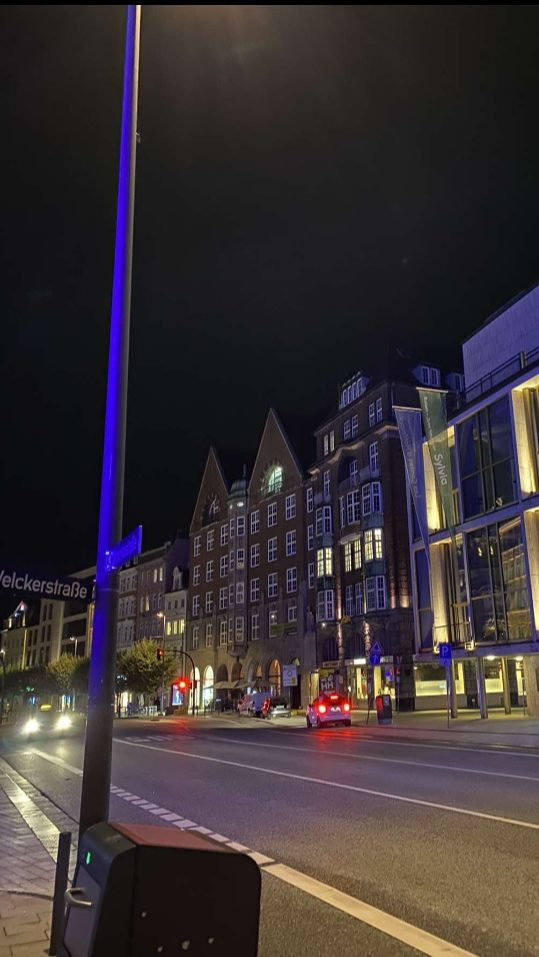 Pictured is Hamburg's inner-city district at night. The image shows residential, brick buildings that border the street as cars pass by below.