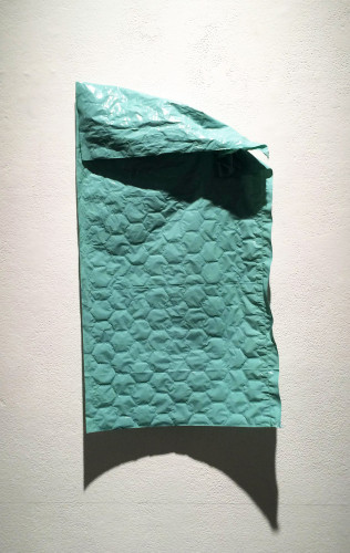 Curtis Ames, Unbubbled Wrap, 2014; plastic, air, 14 by 22 by 3 inches.