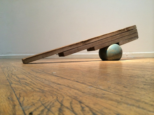Curtis Ames, Pressured Ball, 2014; wood, ball, air, 50 by 9 by 12 inches. (Image: Candice Greathouse)