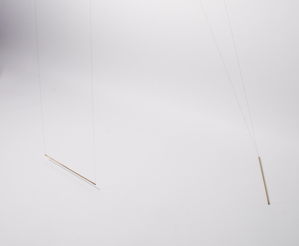 Curve, 2013 (detail). Black thread and three brass bars, 96 x 24 x 24 in.