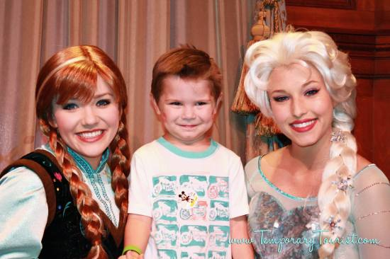Anna and Elsa pose with Carson at the Princess Fairy Tale Hall at Magic Kindgom's Fantasyland.