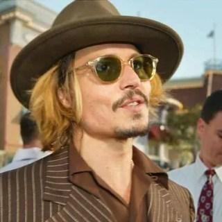 Johnny Depp accusa Amber Heard di ricatto con foto