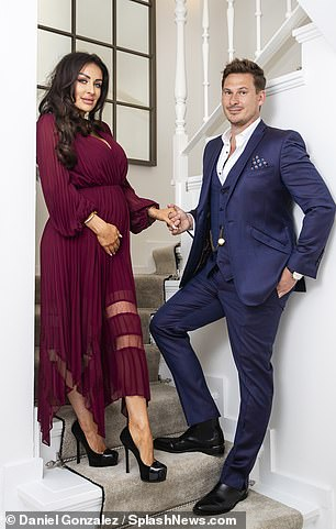 Gorgeous:Verity showed off her pregnancy curves in a plunging burgundy gown boasting pleats and sheer segments