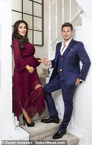 Dapper: Taking things inside, the couple slipped into red carpet attire, with Lee in a navy three-piece suit worn with an open-collared white shirt