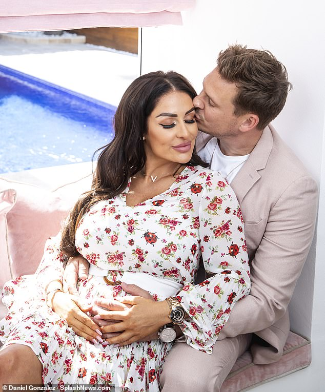 Sweet kisses: Lee showered Verity with affection as they had photographs taken