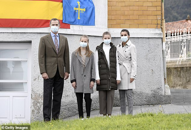 Family: King Felipe and Queen Letizia with daughters Leonor, left, and Sofia, 13, last year