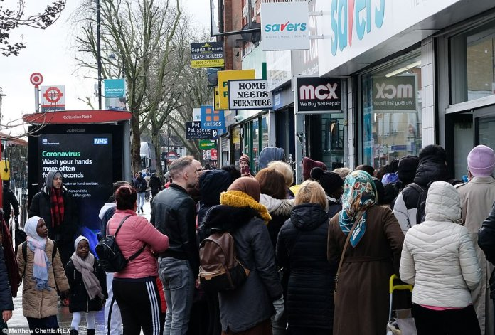 Crowds gathered on paths beside Sainsbury's in Ladbroke Grove and Savers in Wood Green (pictured), both London, as the threat of a lockdown loomed last year