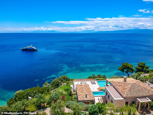 Aerial view over the southern kiathos island, Greece with modern hotels and luxurious villas