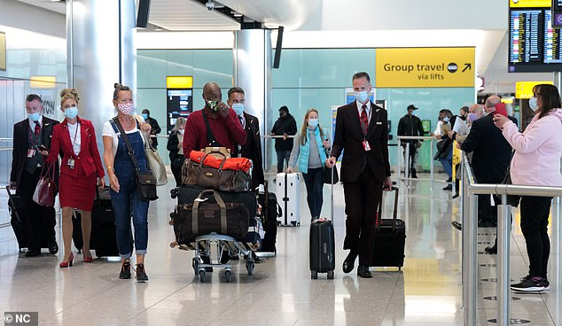 On Monday the outright ban on foreign travel was replaced by a green, amber and red traffic light system grading different countries by their Covid risk level. Pictured: Heathrow Airport on Wednesday