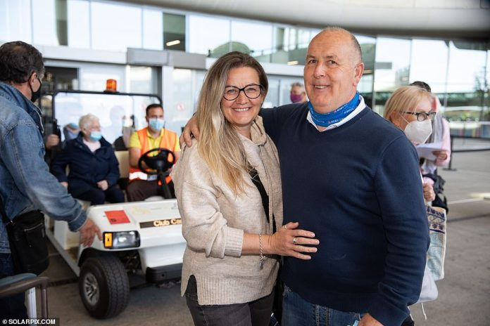 At Malaga Airport today, Janean Holbrook, 50, from Norwich, travelling with husband Rory, 58, said: 'We've been desperate to come because we've got a holiday place in Fuengirola that suffered flood damage'