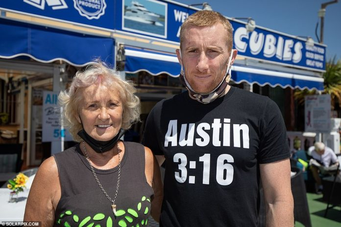 Scoobies Bar owner Stacy Edwards and his mother Jayne Williams outside the bar in Fuengilrola Marina on the Costa Del Sol today. Mr Edwards, 35, said: 'We're hoping things are going to pick up now they're letting British holidaymakers in'