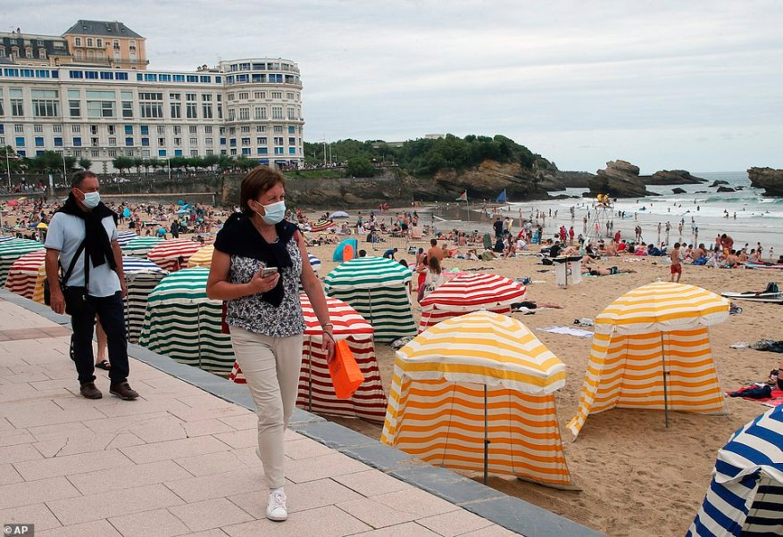 Travel experts believe ministers are preparing to axe the amber plus and green watchlist categories. Scrapping the former would mean reopening travel to and from France. A beach in Biarritz is pictured on July 28