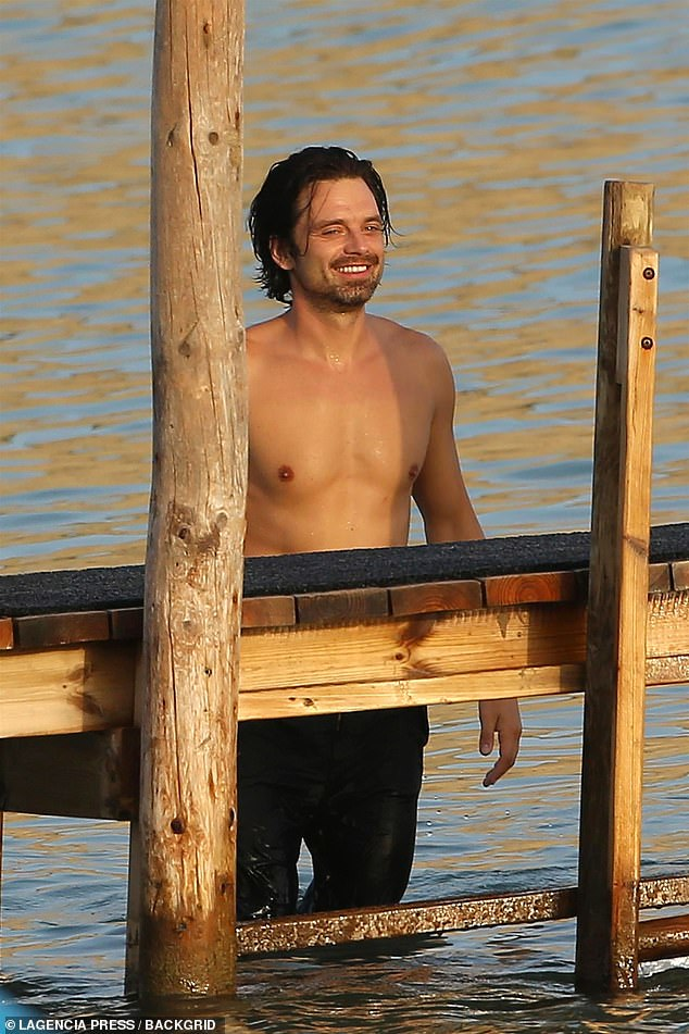What a happy guy: He climbed down the pier into the water