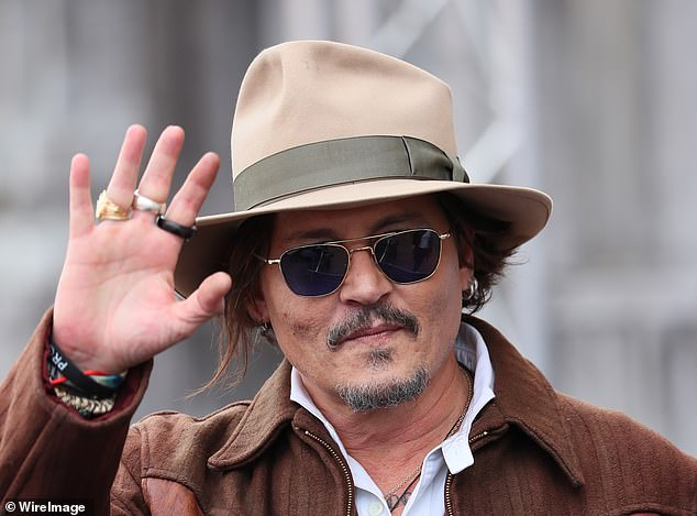 Greetings:The Hollywood star waved at fans while making his way towards a waiting car in the picturesque Spanish coastal city