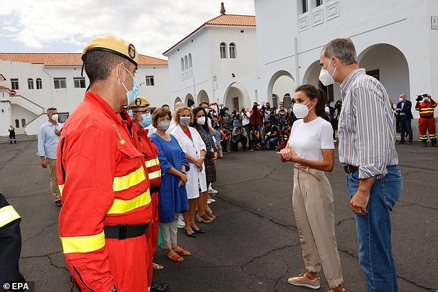 The Spanish royals are seen chatting with the emergency services members who helped in the evacuation due to the volcanic eruption