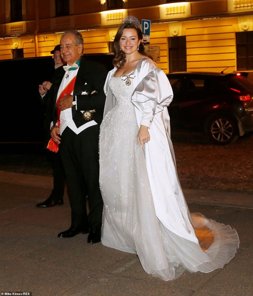 The bride later changed into a second stunning gown, a fairytale crystal embellished gown, with a satin coat featuring statement puffed sleeves over the top, as she arrived for the evening gala at the Russian Museum of Ethnography on the arm of her diplomat fatherRoberto Bettarini.
