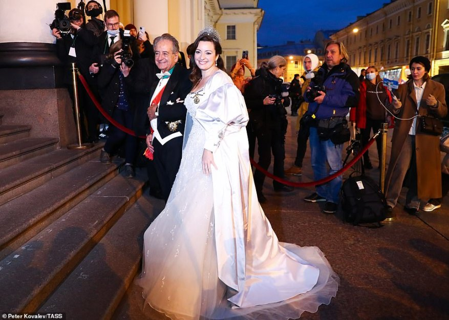After the religious ceremony, the bride changed into a fairytale-inspired second wedding dress (pictured with her father Roberto) embellished with crystals to continue the celebrations at an evening gala at the Russian Museum of Ethnography.
