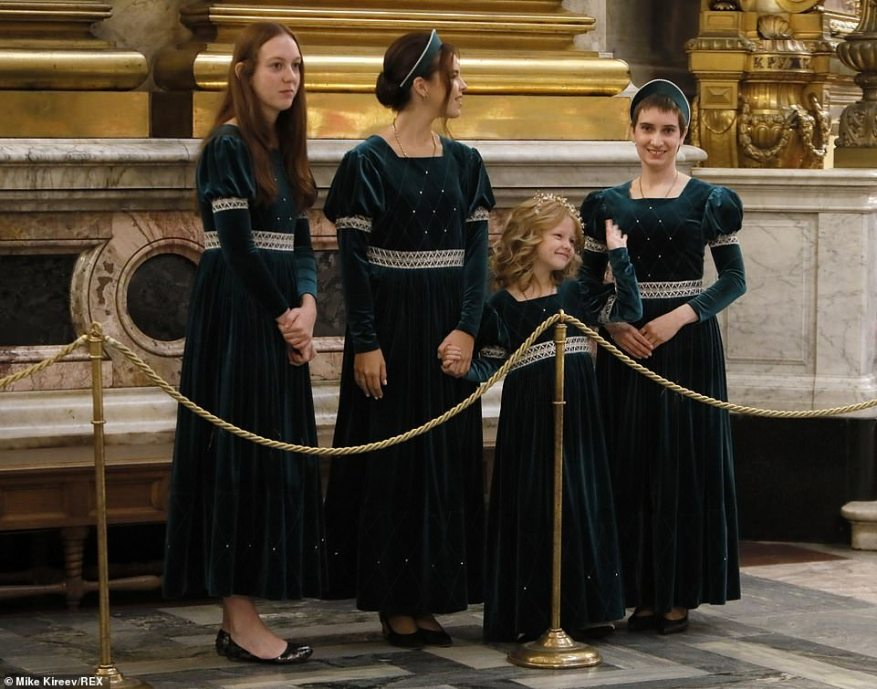 Meanwhile, bridesmaids at the event opted for a velvet green dress with medieval style puff sleeves (pictured together).